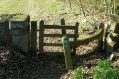 The same Wooden Kissing Gate, leaving Meriden Church Yard, but becoming worse for wear and effects of subsidence : 26-Mar-2012 : photo Peter Page