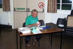 4-Sep-2005 at 06:32 : Meriden Village Hall : Bob Carey checking the records