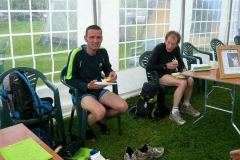 13:33 : Boots off, a rest, a meal and still smiling!  The first to get back.